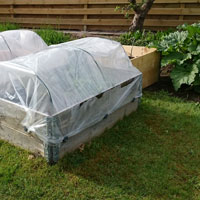 Apply poly covers with clips to help Garden Grow Beds grow